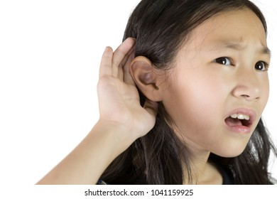Asian girl listening by handâs up to the ear isolated on white background,Children with Hearing Impairment.