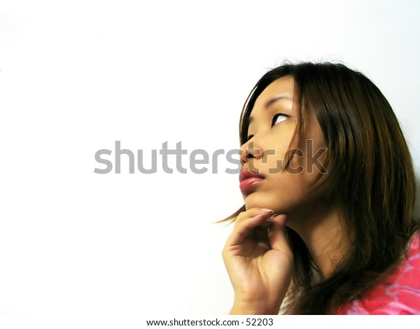 an asian girl looking sideways