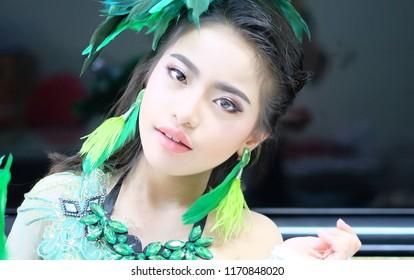 Asian girl makeup and wearing green fancy dress