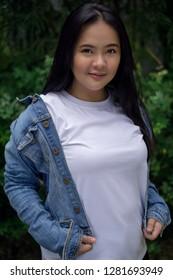 Asian girl modeling white T-shirt with jacket