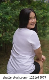 Asian girl modeling white T-shirt