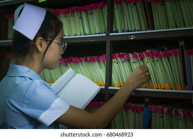 Asian girl nurse working document