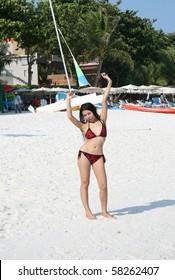 Asian girl on beach, Thailand.