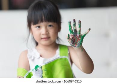Asian girl painted on plaster doll.