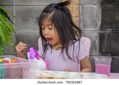 Asian girl painting. Painting is play therapy for ADHD kids (Attention deficit hyperactivity disorder),can be used to address emotional problems.