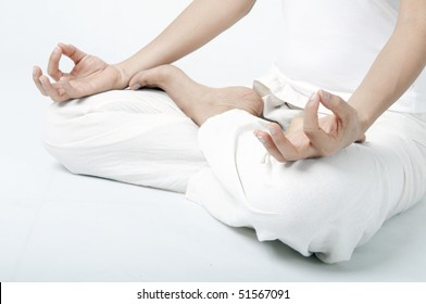 asian girl performing yoga  meditation close up shot on hand and sitting position