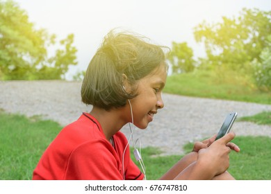 Asian girl playing smart-phone for education to do homework