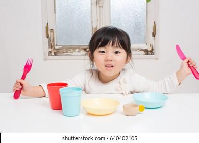 asian girl plays house