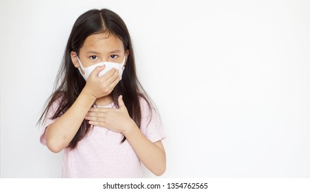 Asian girl with protect mask standing on white background