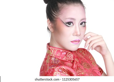 Asian girl puts on fashion makeup face wears qipao, chinese dress with white background.