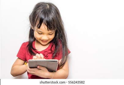 Asian girl is reading E book on Tablet.