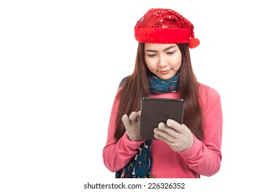 Asian girl with red christmas hat use tablet PC  isolated on white background