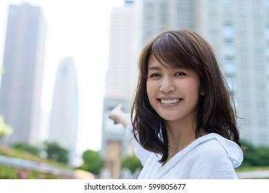Asian girl relaxing outdoor in Tokyo.