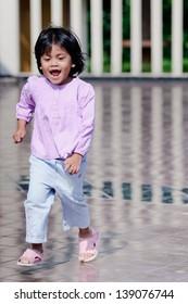asian girl running outdoor