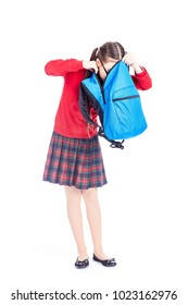 Asian girl in school uniform searching for something in her backpack