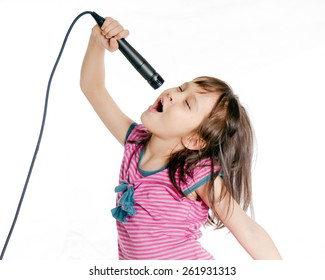 Asian girl singing with a microphone
