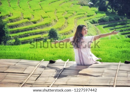 41505dc51 Asian girl sitting on a wooden balcony at Pa Bong Piang Rice Terraces,  Famous attractions