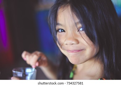 Asian girl smiled happily enjoy eating Focus on the eyes