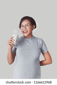 Asian girl smiles when she was drinking milk.Focus on face