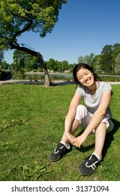 Asian girl smiling in the park