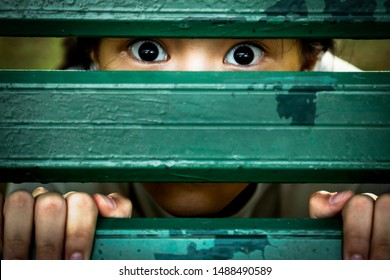 Asian girl sneak peek,peeping spying eyes,suspiciously child feel afraid fear,frightened or saw something scary with fixed eyes,shock or terrified,female psychiatric patient,mental disorder,mistrust