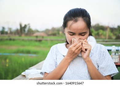 Asian girl with sneeze feeling with paper on hand for cleaning wet. people health care living life concept for healthy lfiestyle