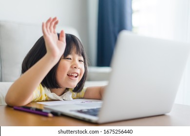 Asian girl student online learning class study online video call zoom teacher, Happy girl learn english language online with laptop at home.New normal.Covid-19 coronavirus.Social distancing.stay home  - Shutterstock ID 1675256440
