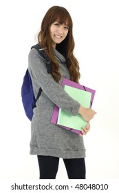 Asian girl student smiling and holding notebooks