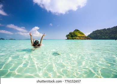Asian girl swimming in Kam beach between Koh Kood and Koh Mak in Thailand sea, Island in Thailand and Asia, This immage can use for Summer, Holiday and travel concept