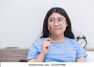 Asian girl teen thinking consider about work plus size nerd wearing glasses people