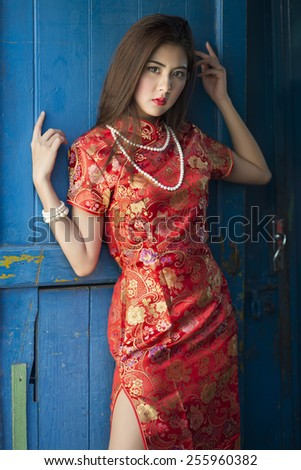 5e9330996 Royalty-free stock photo ID: 255960382. asian girl in traditional chinese  cheongsam red dress - Image