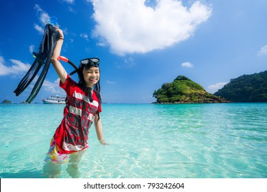 Asian girl travel Thailand sea in Phuket . Child play water, swim and diving. This image can use for Travel, Holiday and Summer concept.
