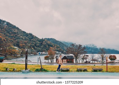 Asian girl is traveling at Chuzenji Lake, Nikko, Toshiba, Japan, in autumn.