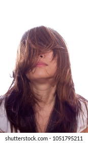 Asian girl under the white background with the hair blown by wind
