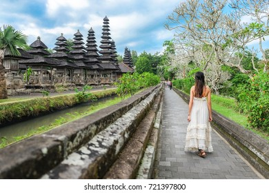 Asian girl walking in Pura Taman Ayun Temple in Bali, Indonesia.