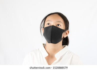 Asian girl wearing a black mask on a white background with concept
