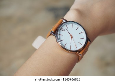 Asian girl is wearing hand watch.