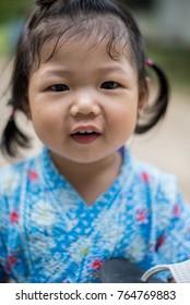 Asian girl wearing a Japanese dress, jinbei