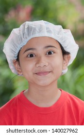 asian girl wearing shower cap and shows funny face