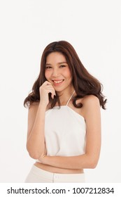 An Asian girl in white dress smiling with white background.