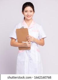 An Asian girl in white nurse's uniform