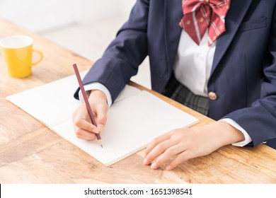 asian girl who study,School uniform, hands, body parts
