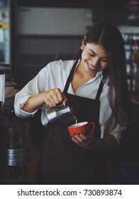 Asian girl working in coffee shop cafe barista concept