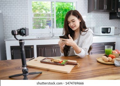Asian girls cooking in the kitchen.