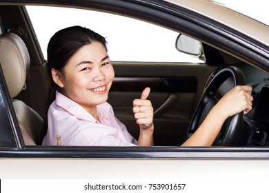 Asian girls driving with joy.