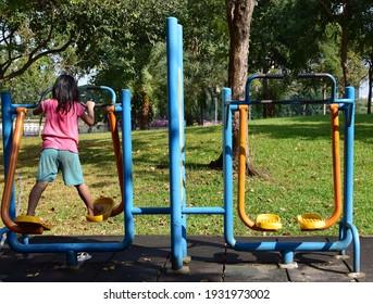 Asian girls exercising in the park