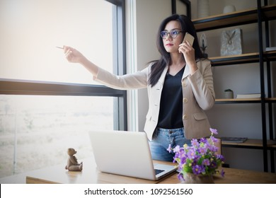 Asian girls Asian female accountant or banker perform calculations. Financial Savings and Economic Concepts
