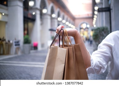 Asian girls holding sale shopping bags. consumerism lifestyle concept in the shopping mall