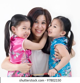 asian girls in oriental costume hugging their mother