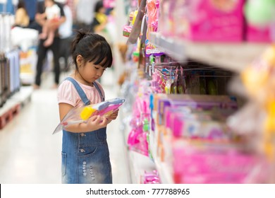 Asian girls shop for toys at department stores